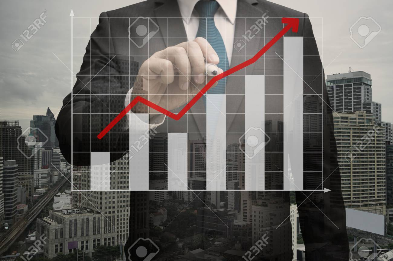 Double exposure of Businessman writing the virtual panel of bar chart , business concept Standard-Bild - 84571303