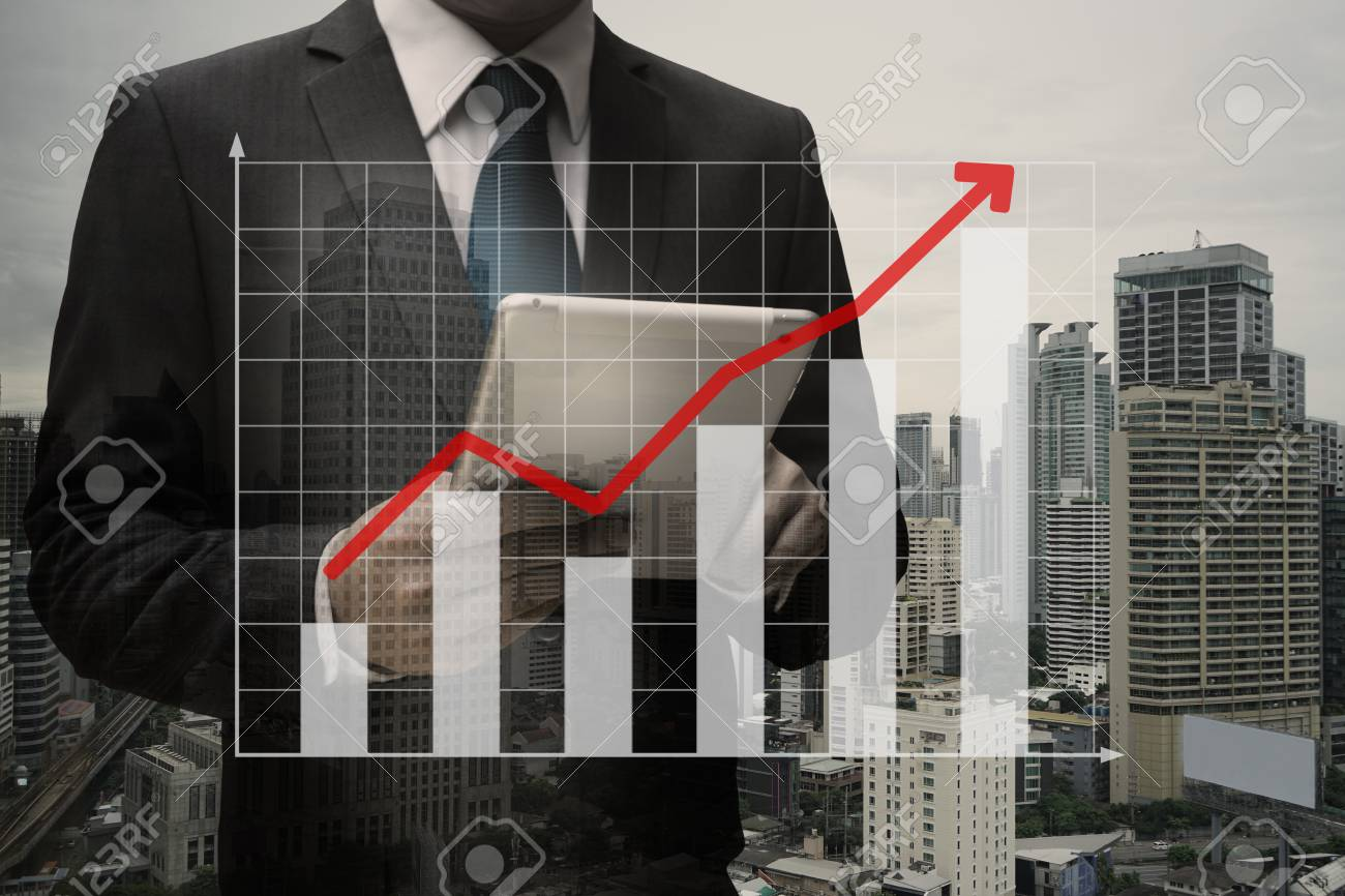 Double exposure of Businessman Using Digital Tablet with the virtual panel of bar chart , business concept Standard-Bild - 84571304