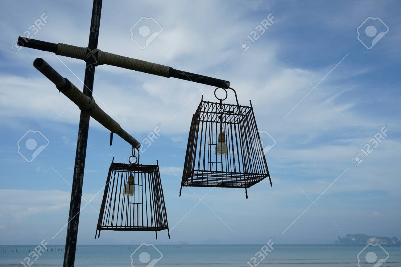 Outdoor lamp made of bird cage on blue sky background Standard-Bild - 90179727