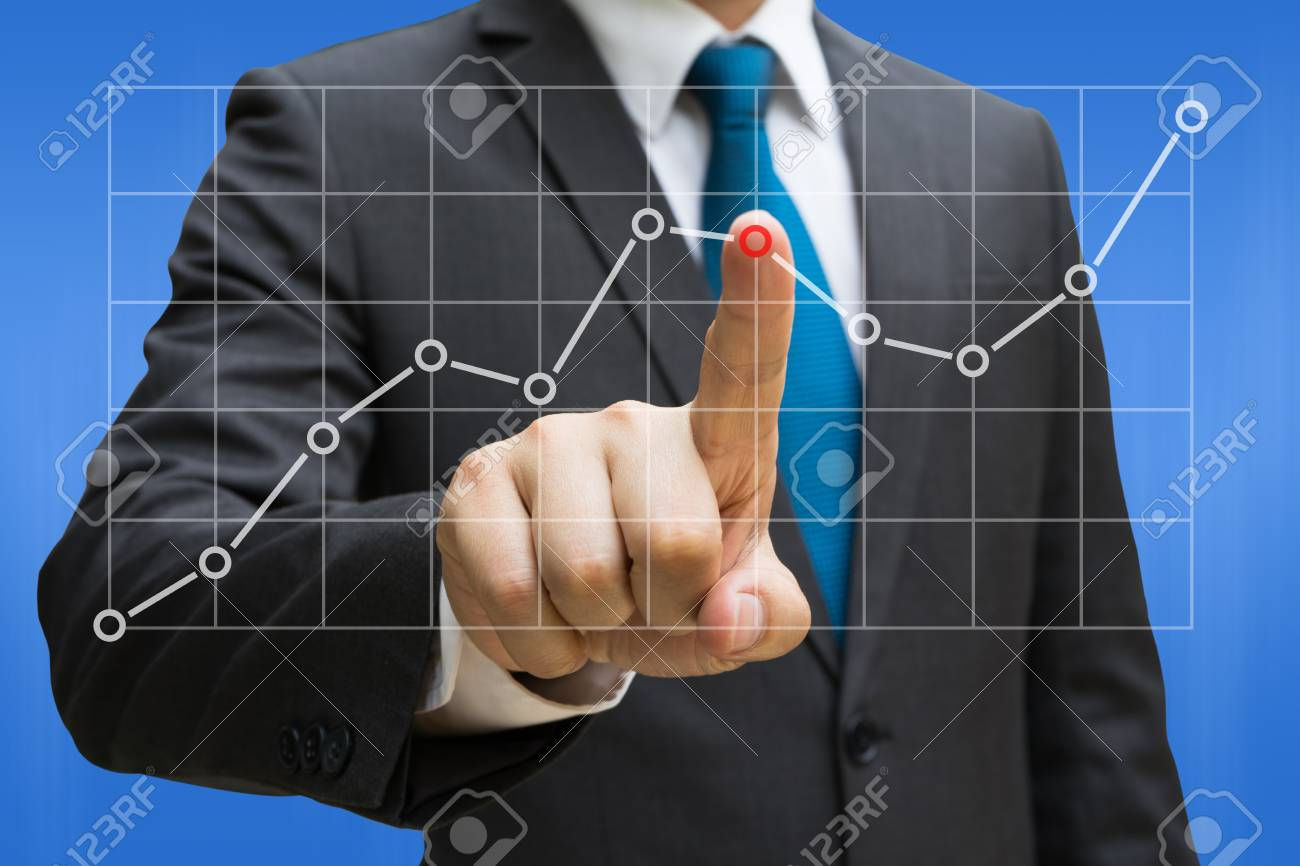 Businessman hand touching the line charts showing growing revenue on touch screen Standard-Bild - 90179729