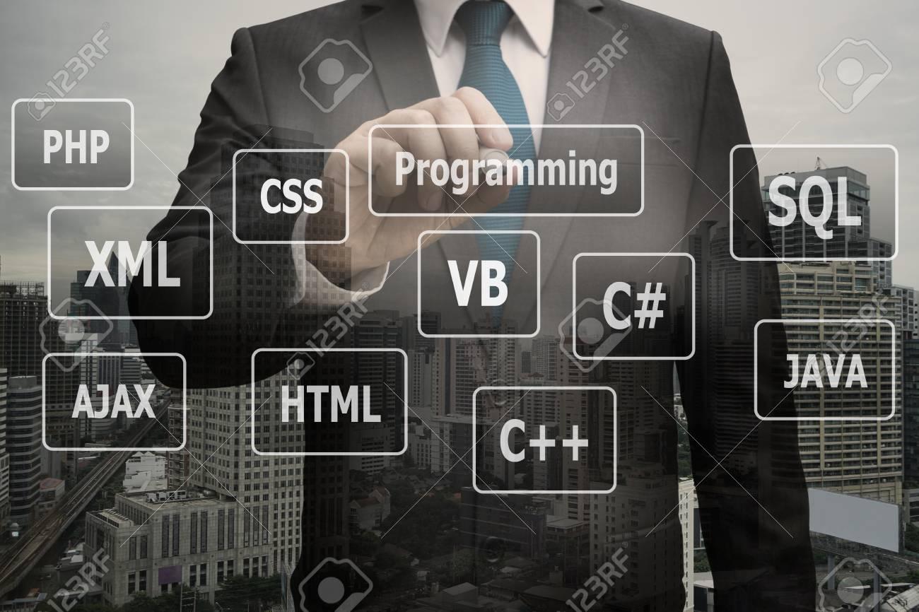 Double exposure businessman hand touching virtual panel of programming languages, Computer technology concept Standard-Bild - 90530983