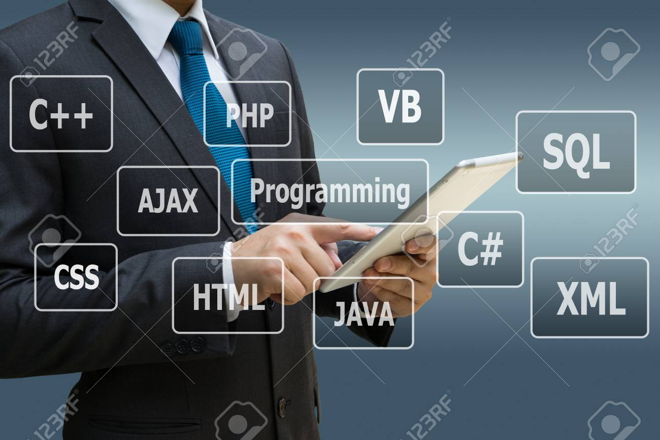 Businessman hand using digital tablet with virtual panel of programming languages, Computer technology concept Standard-Bild - 89777300