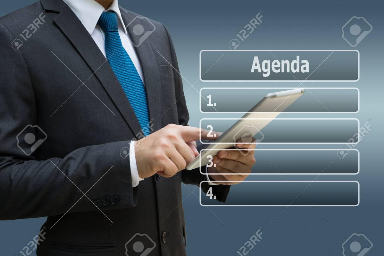 Businessman hand using digital tablet with virtual panel of agenda list Standard-Bild - 90866870