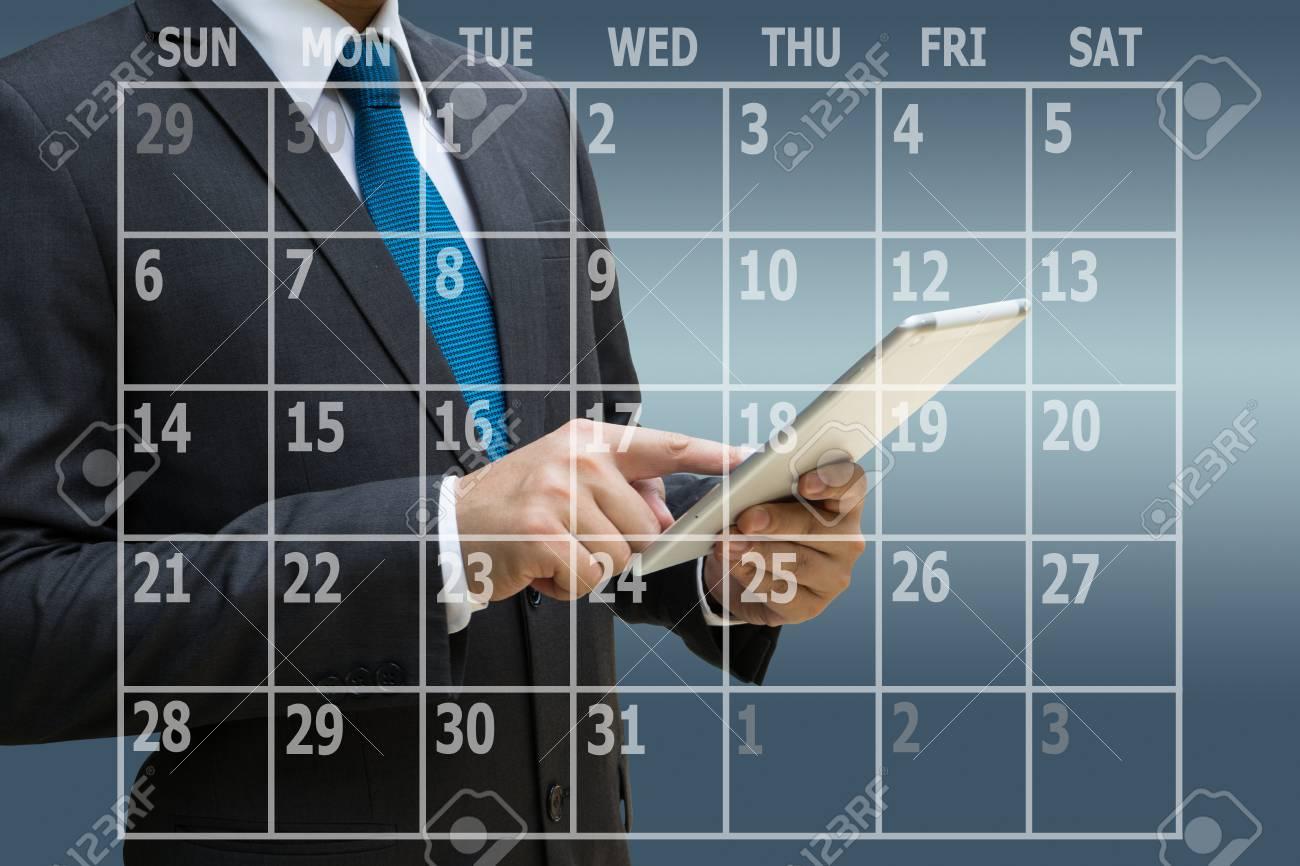 Businessman hand using digital tablet with virtual panel of calendar planner Standard-Bild - 92983388
