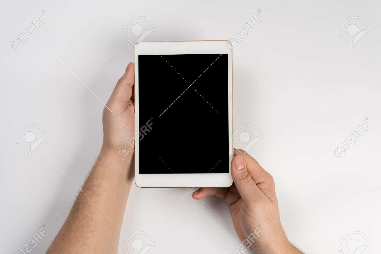 Hand touch on empty screen of tablet above brown table top view, Leave space for display of your content, Technology concept, mock up for montage your content - 120144989