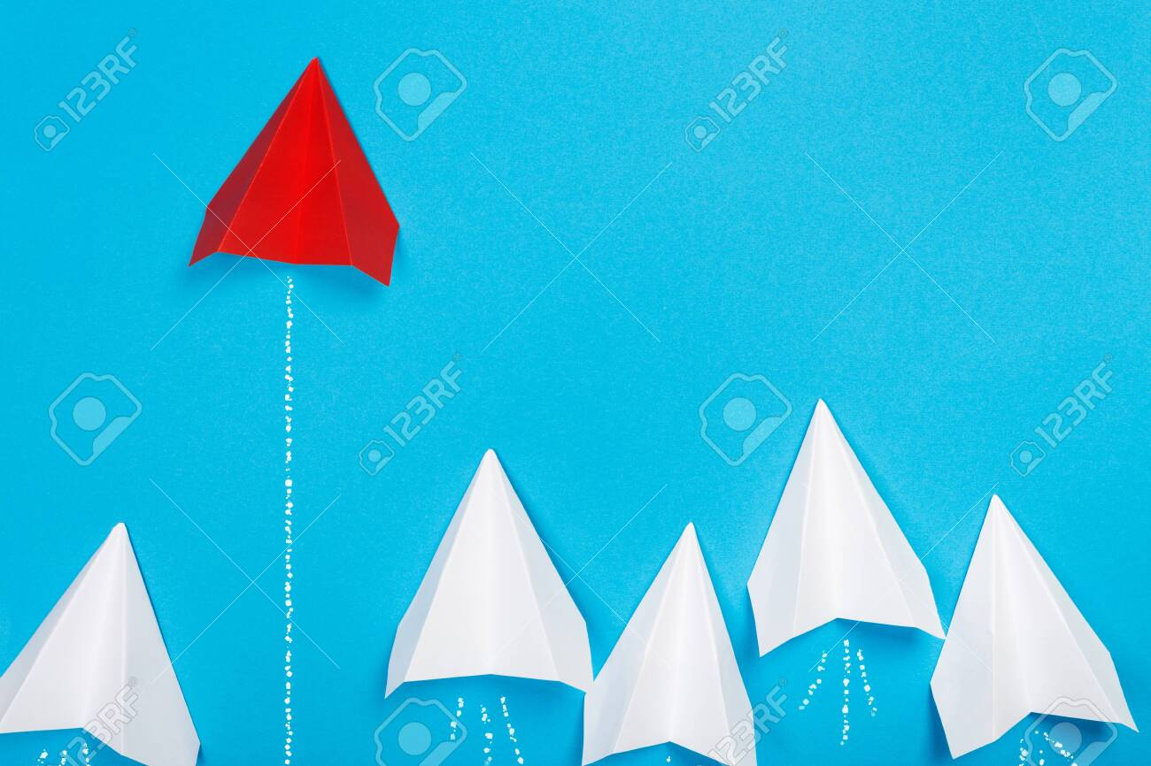 Red paper plane are different from others on blue background. Think different. Business for innovative, solution concepts - 131916695