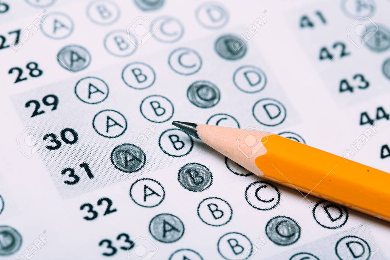 pencil for the exam. printed school testAnswer sheet - 138724063