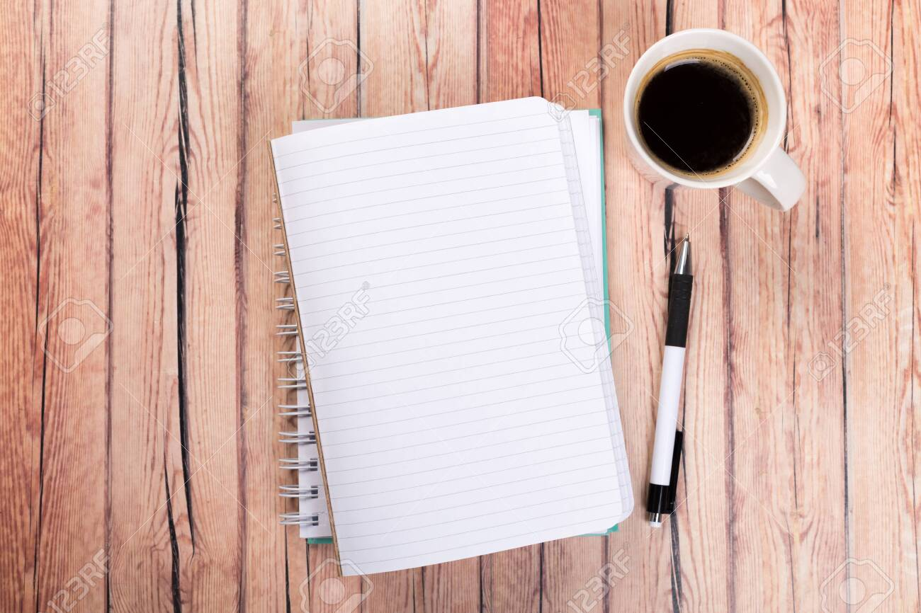 Empty paper notebook on brown wooden table background. Top view Concept of a new workplace of office desks. - 141306088