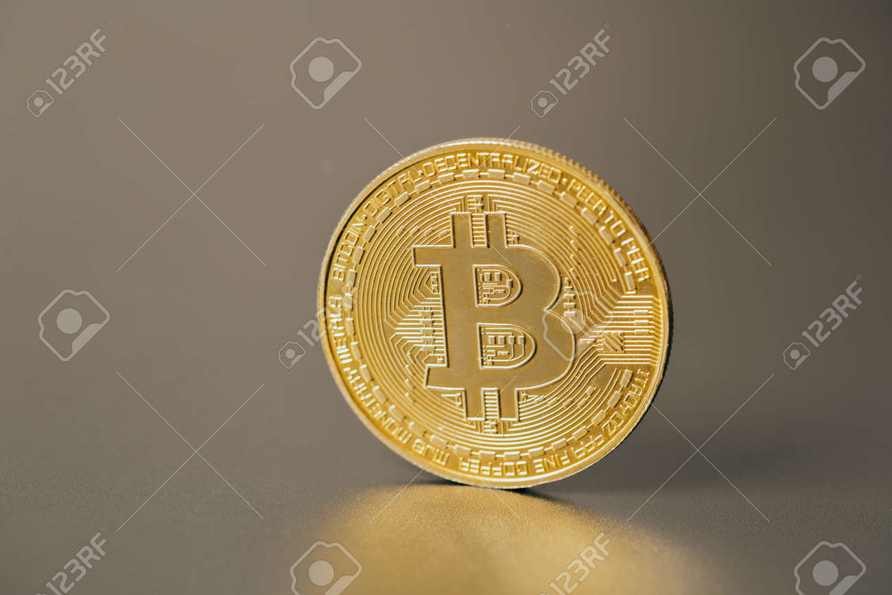Bitcoins and new virtual money on plain gray background - 159477214