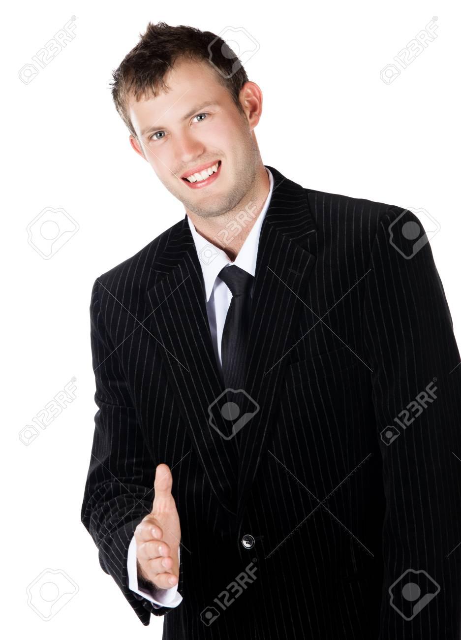 meilleures offres sur bonne qualité nouvelle qualité Beau jeune homme d'affaires caucasien réussi vêtu d'un costume noir formel,  cravate et chemise blanche. Il tient la main pour une poignée de main et ...