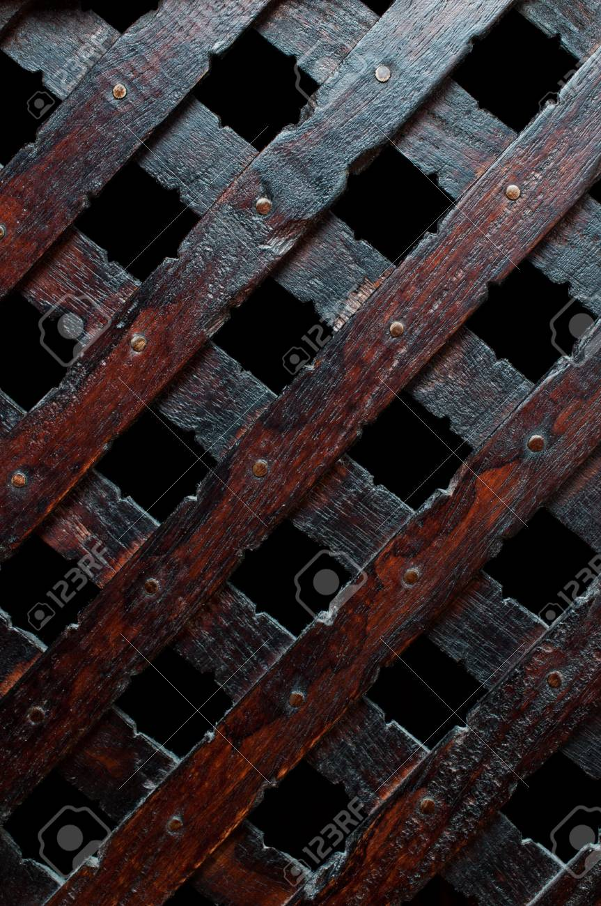 Wooden plank cross bacground with nails dark furniture Stock Photo - 11995929