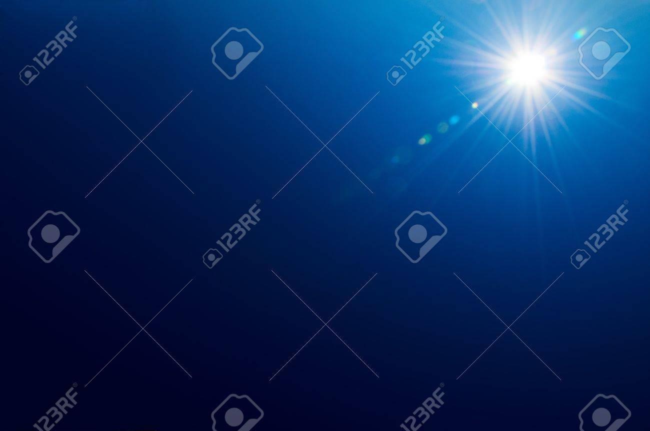 Bright sun on a deep blue sky background Stock Photo - 12196654
