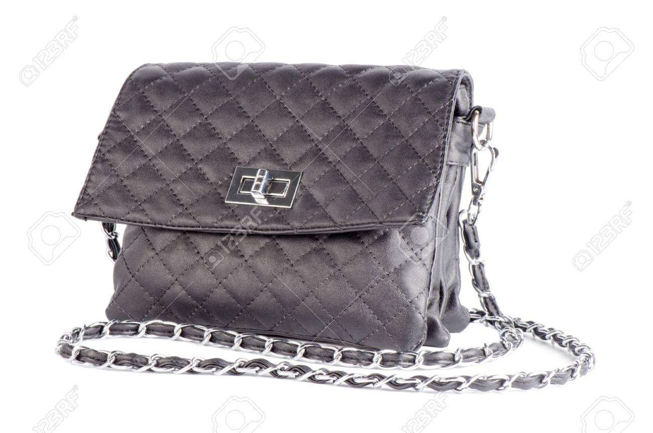 design de qualité magasin grande sélection Beau cuir matelassé noir sac à main femme isolée