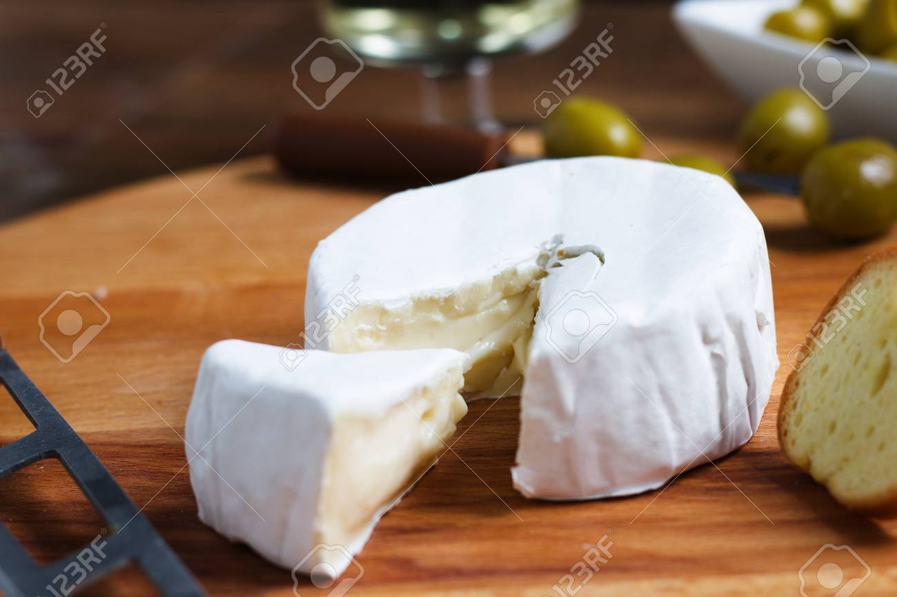 Close Up Shot Of Cut Wheel Of Soft White Rind Cheese Camembert Stock Photo Picture And Royalty Free Image Image 102844634