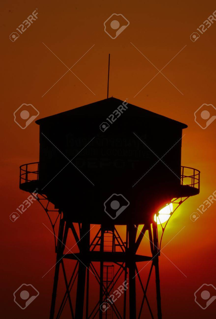 old water tank silhouette at sunset Stock Photo - 18857097