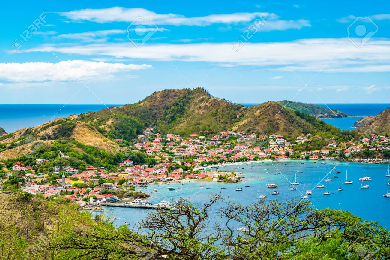Terre-de-Haut, Guadeloupe. Colorful landscape with village, bay and mountains. - 148149005