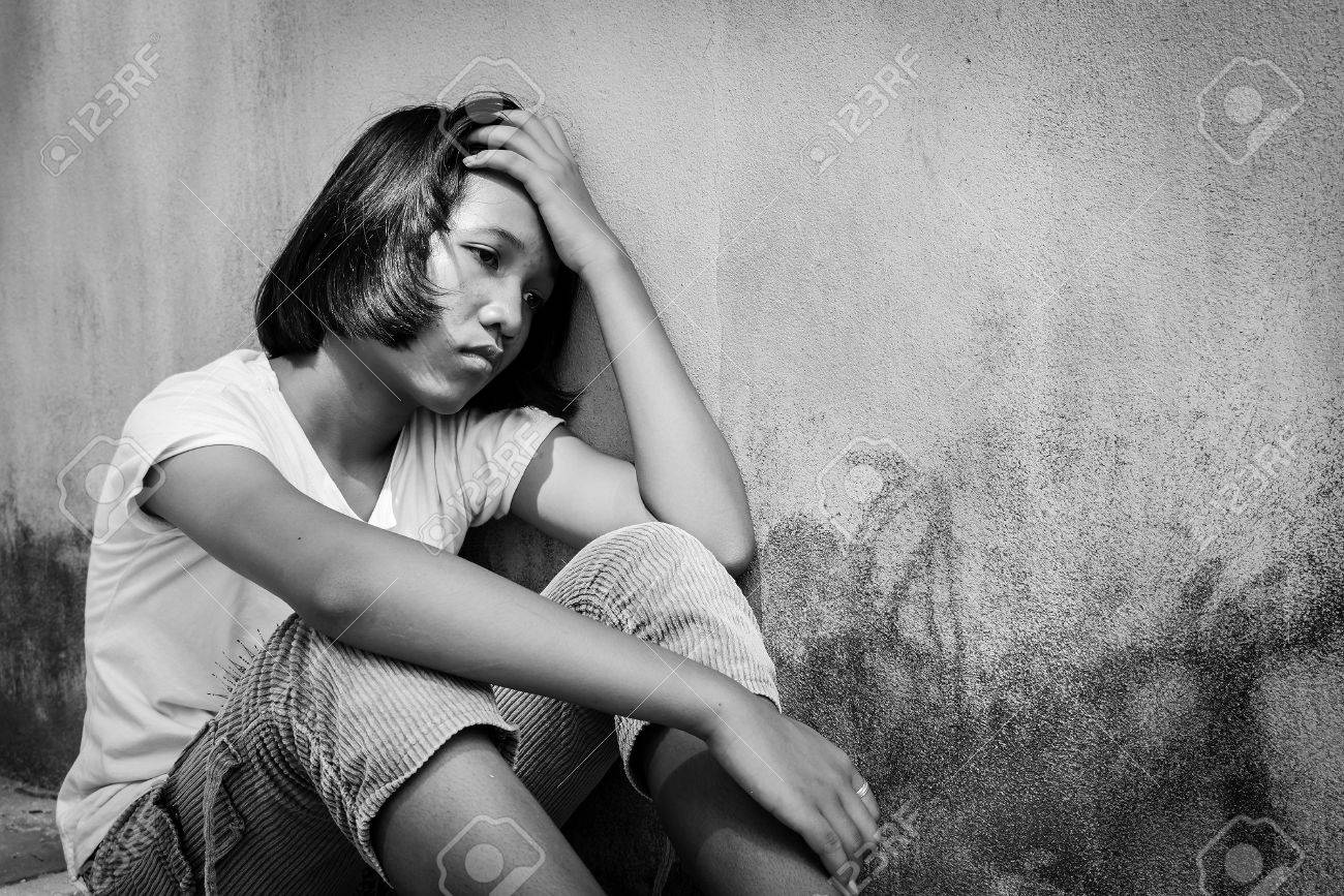 Concept teen proplem sad girl sitting alone black and white tone stock photo 67076929