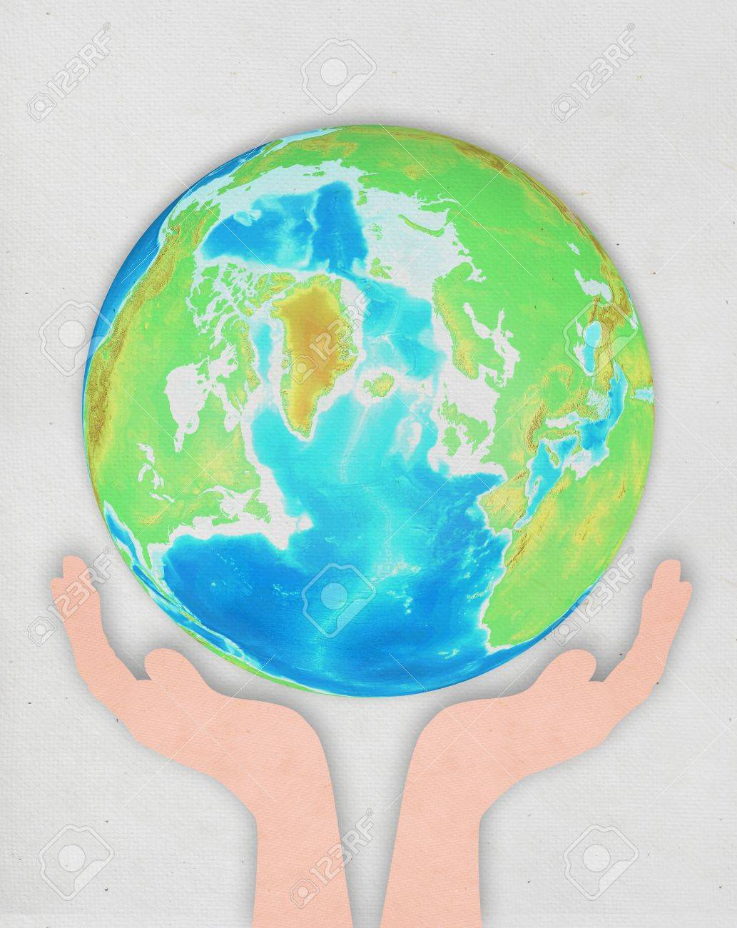 hand holding globe ,paper art design ,save the earth concept Stock Photo - 12812741