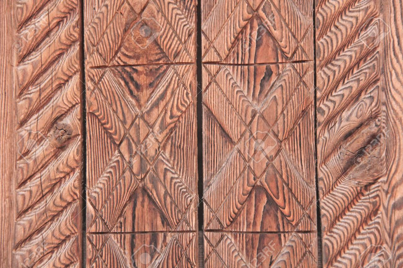 Wood carving geometric ornament of wood background of carved