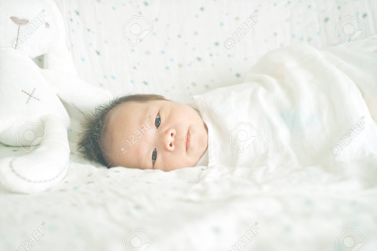 Cute Adorable Newborn Baby Boy Wrapped Or Swaddle In A Blanket