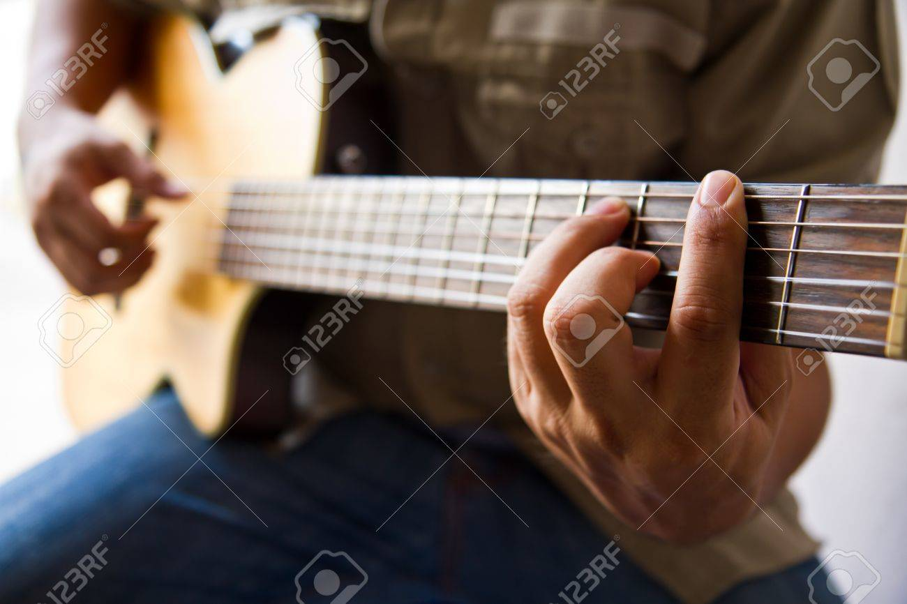 Man Playing A Guitar F Chord Stock Photo Picture And Royalty Free