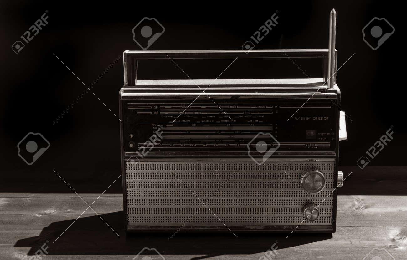 Old radio on a black background - 151590888