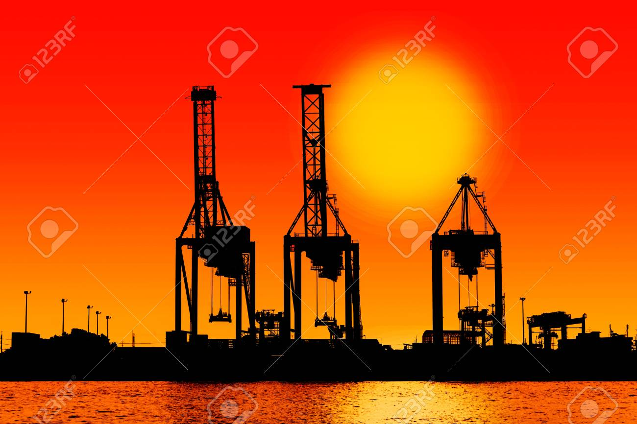 silhouette industrial shipping port with sun Stock Photo - 16630506