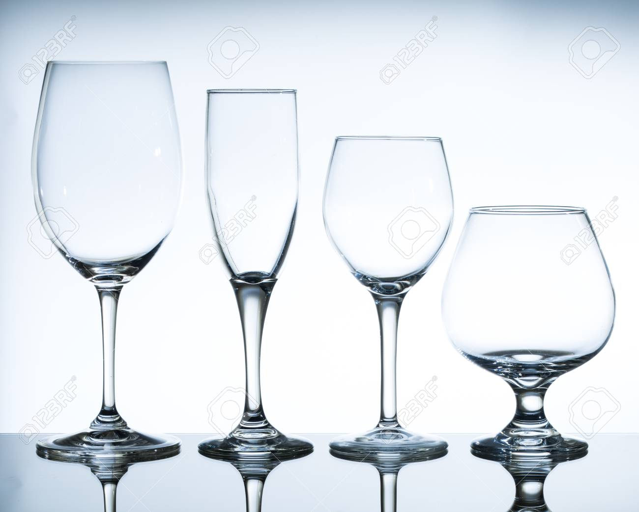 Empty Wine Glasses On The Glass Table And White Background Stock