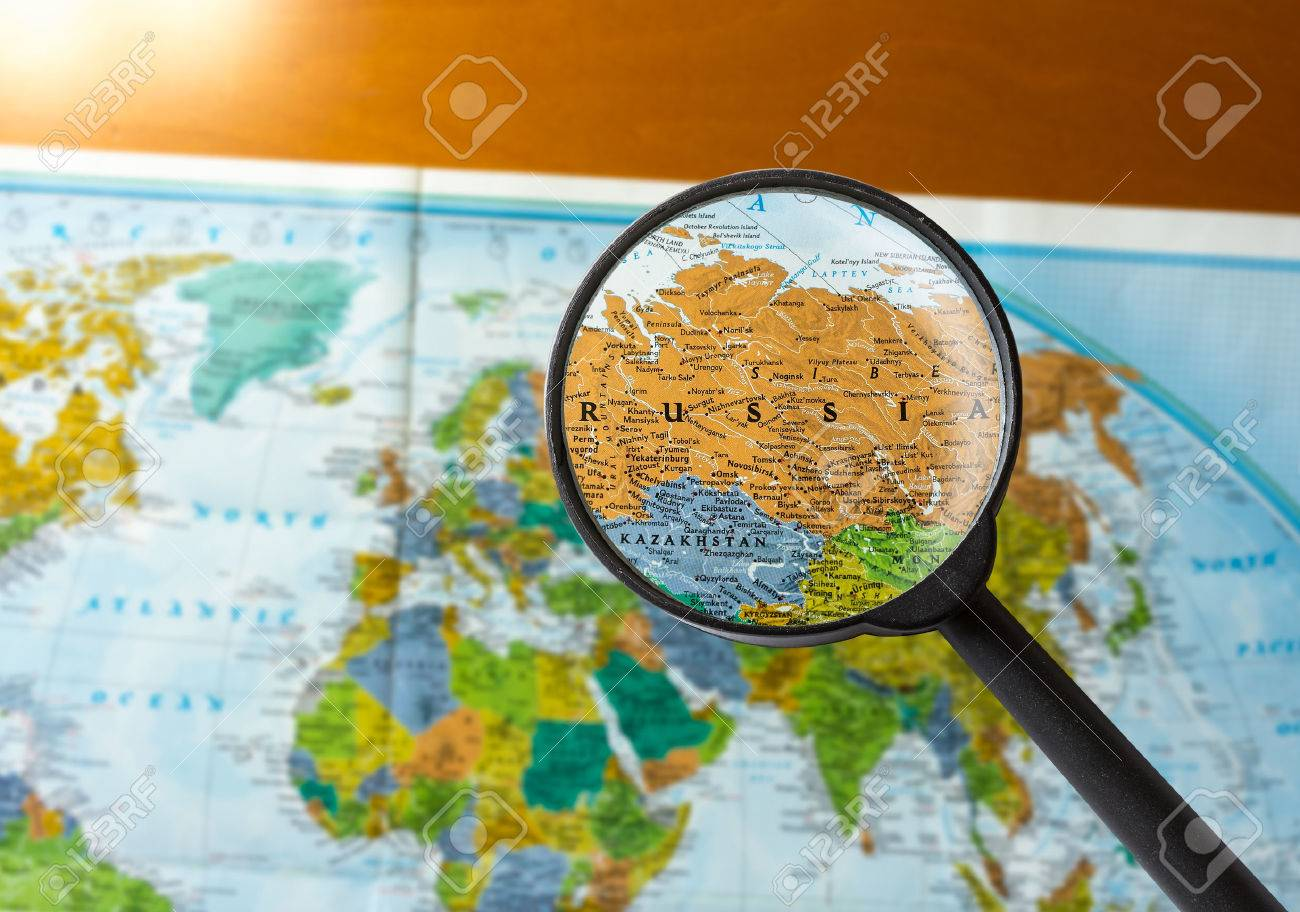 Map Of Russia Through Magnifying Glass Stock Photo Picture And
