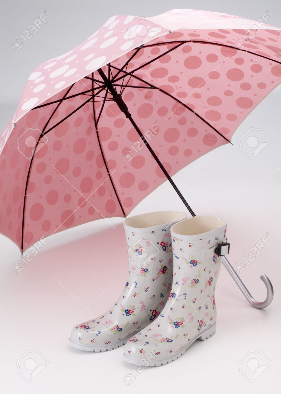 cute umbrella and rubber boots of rainy day stock photo picture and