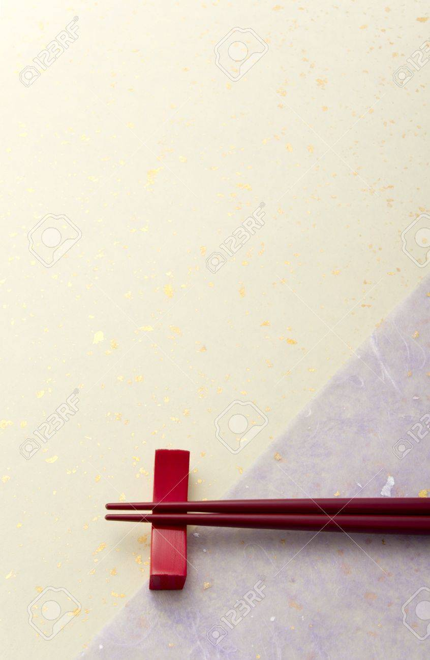 red chopsticks on japanese paper Stock Photo - 13679837
