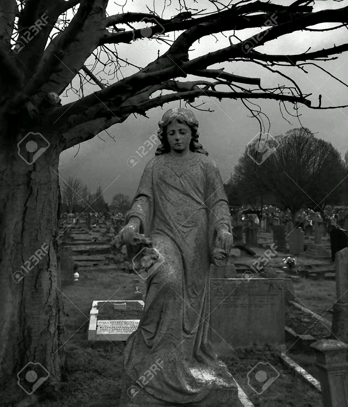 Black and white angel statue in graveyard stock photo 26634938
