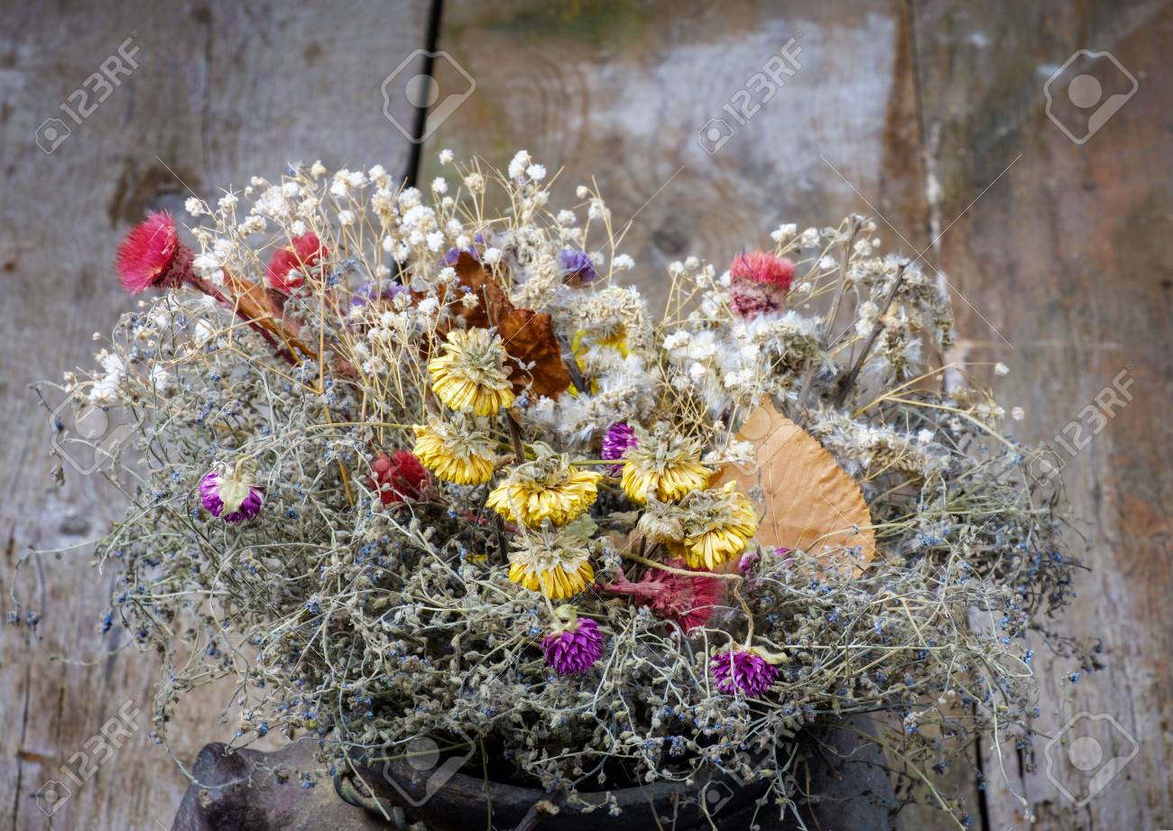 Dried Flowers Bouquet In The Jug On A Rusty Wooden Background Stock ...