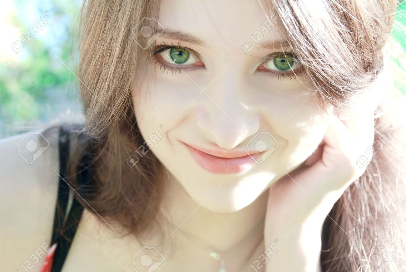 e54aaf6be01fb9 Portrait of beautiful girl with green eyes on nature background