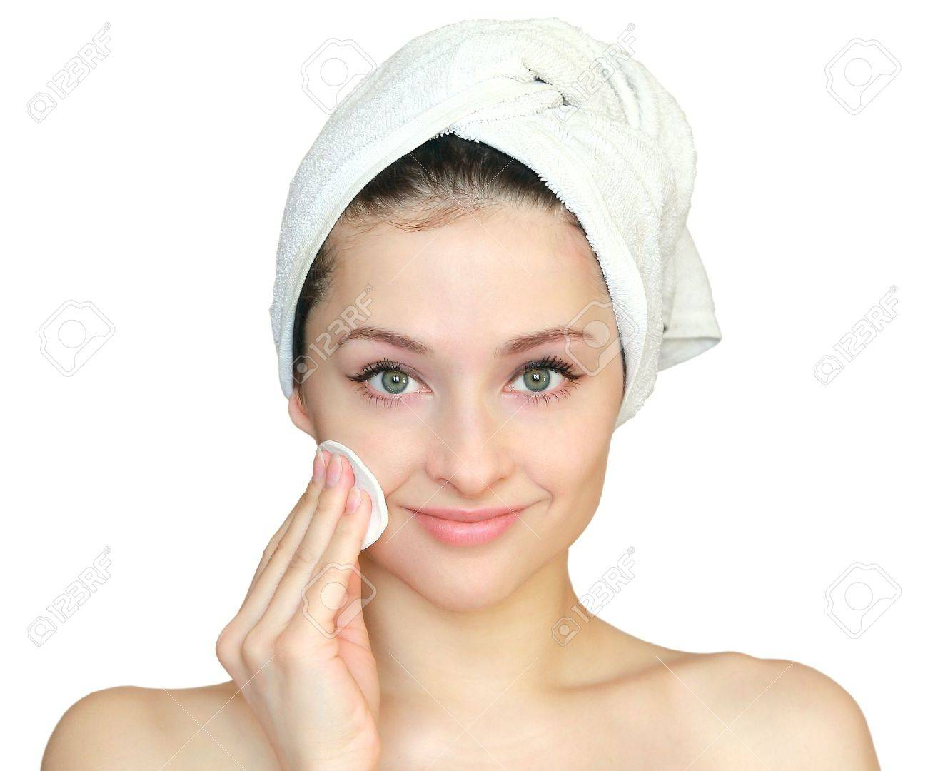 Beautiful young woman cleaning tampon the skin on face after bath in towel on the hand isolated on white background. Closeup portrait Stock Photo - 12361825