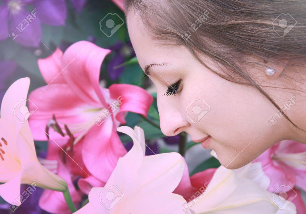 Sensual portrait of beautiful girl smelling colorful lilies on sensual portrait of beautiful girl smelling colorful lilies on spring nature seasonal nature flowers izmirmasajfo