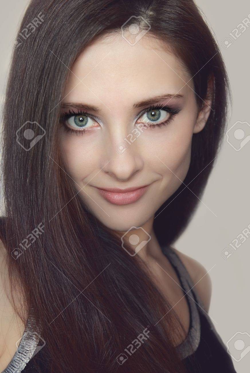 Young woman with healthy long hair and green eyes looking  Closeup soft portrait Stock Photo - 13375784