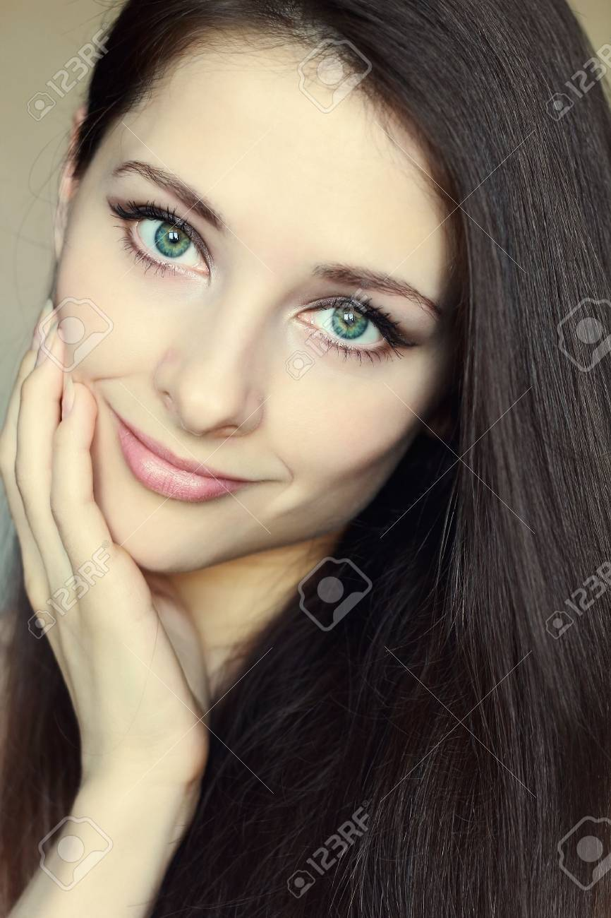 42f2c0a702d0ae Portrait of beautiful woman touching clean face with green eyes..