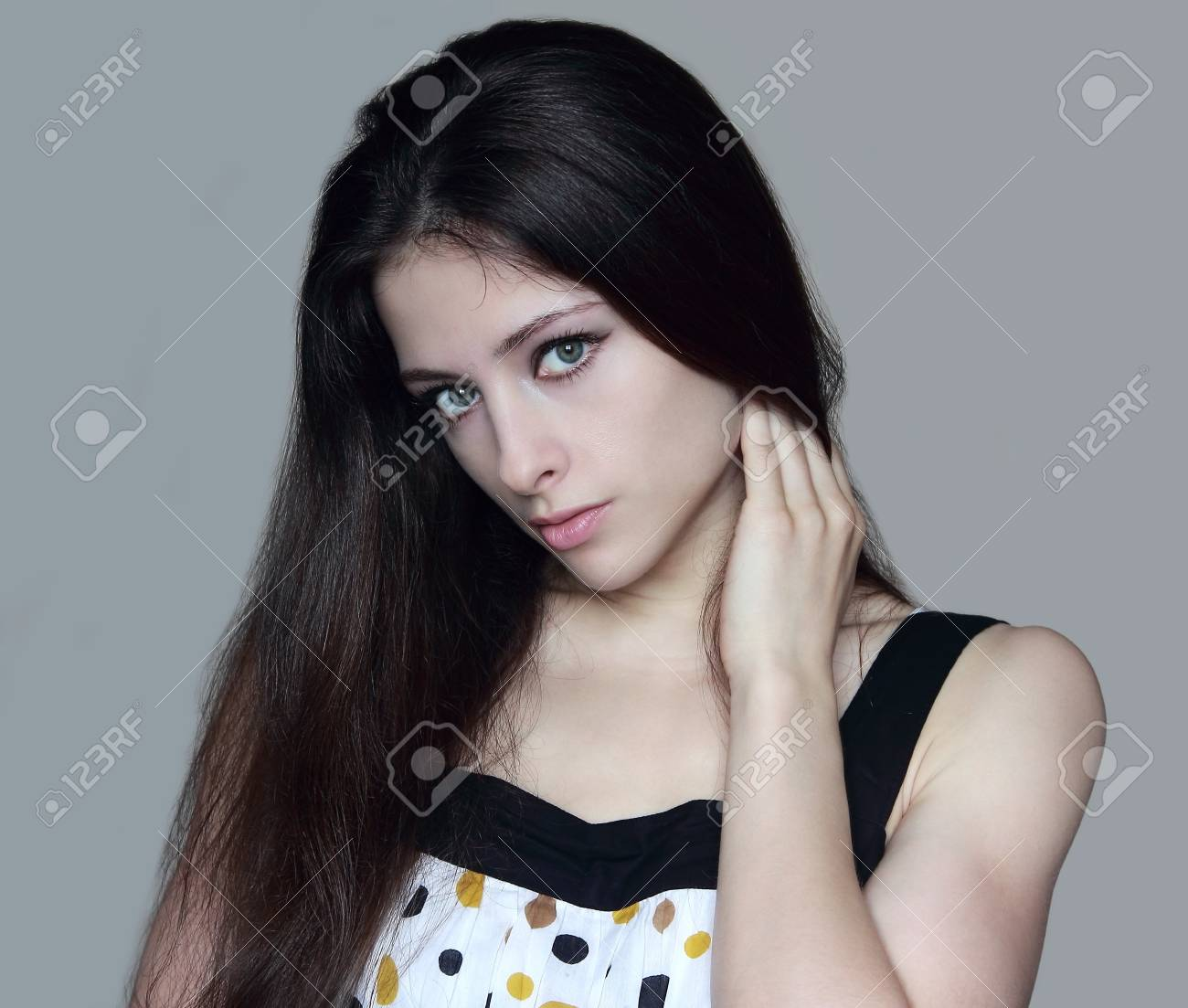 Beautiful girl holding hand long hair and looking sexy  Isolated portrait Stock Photo - 14715964