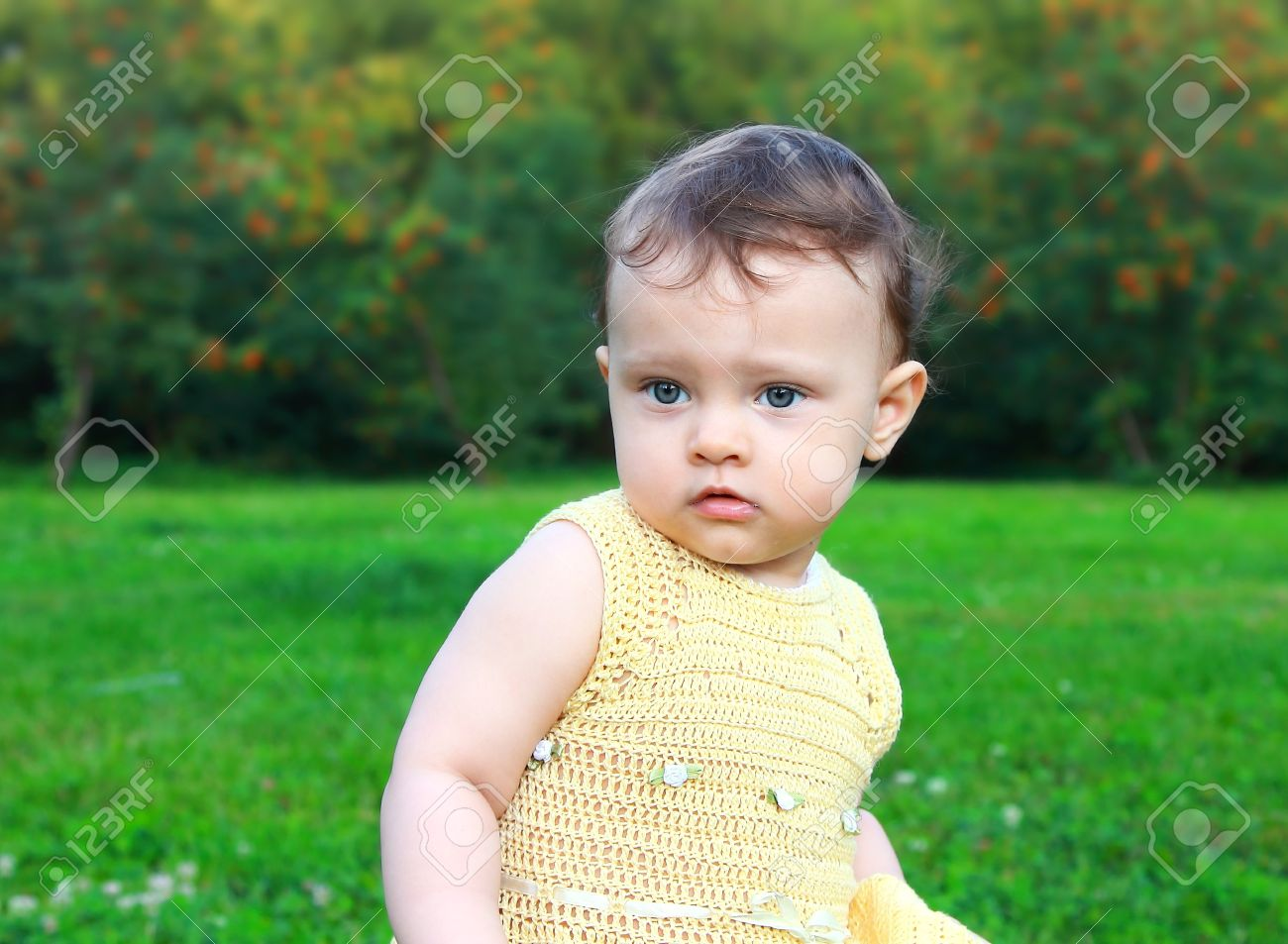 Beautiful surprised baby girl looking on nature green background  Fun closeup portrait Stock Photo - 14715970