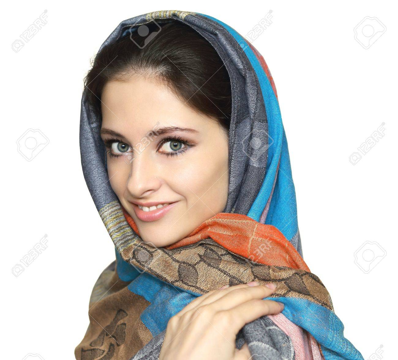 Beautiful smiling woman in colorful shawl isolated on white background  Close portrait Stock Photo - 15762214