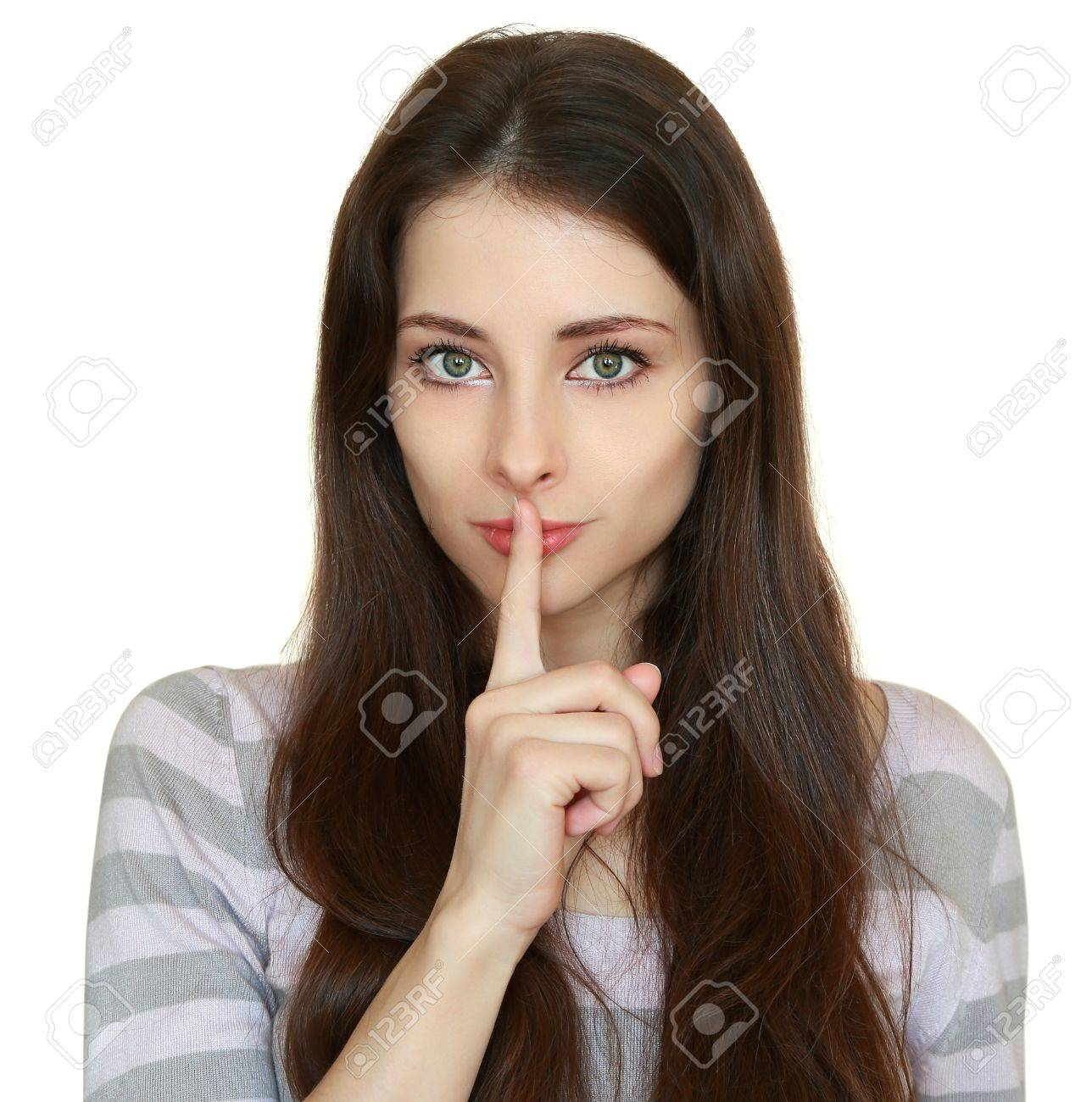 Beautiful woman showing silent sign and holding finger over lips isolated on white background  Closeup portrait of long hair girl Stock Photo - 18268504
