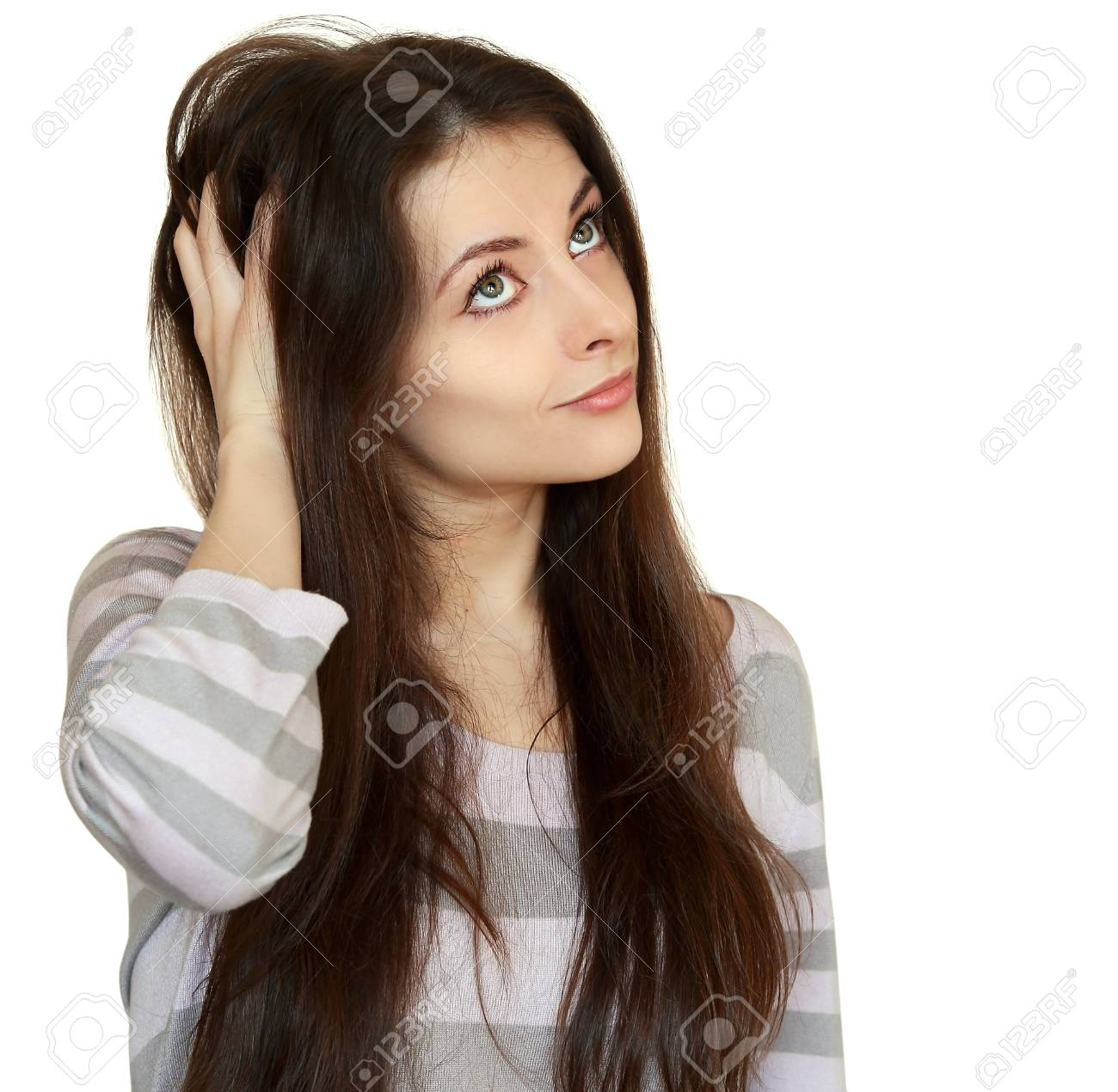 Thinking woman holding hair and looking up  Closeup portrait isolated on white background Stock Photo - 18443592