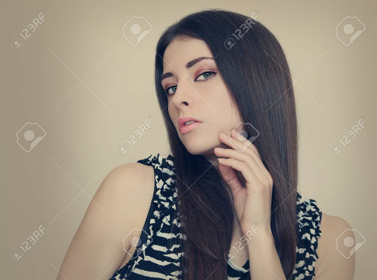 Vogue style portrait of beautiful sexy woman holding hand face Stock Photo - 18857113