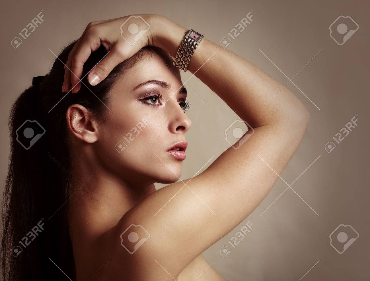 Sexy beautiful woman with modern watch on the hand  Color portrait Stock Photo - 24255518