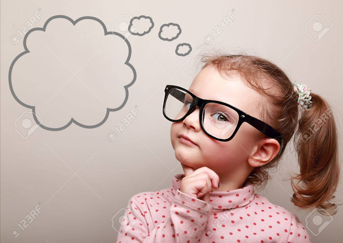cute thinking kid girl in glasses with empty bubble looking stock