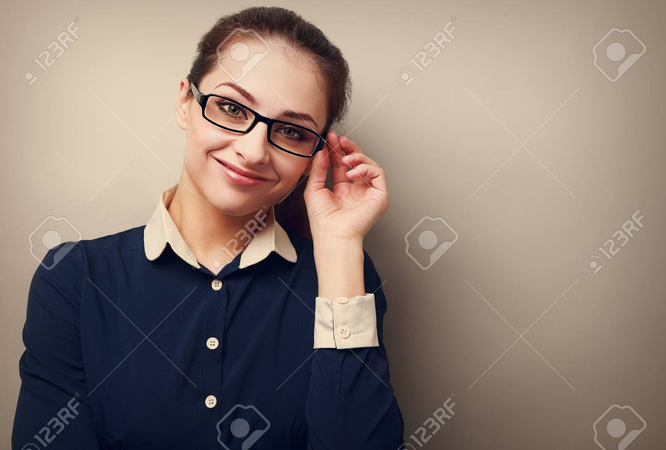 Happy business woman in glasses looking on copy space empty background Stock Photo - 28300473