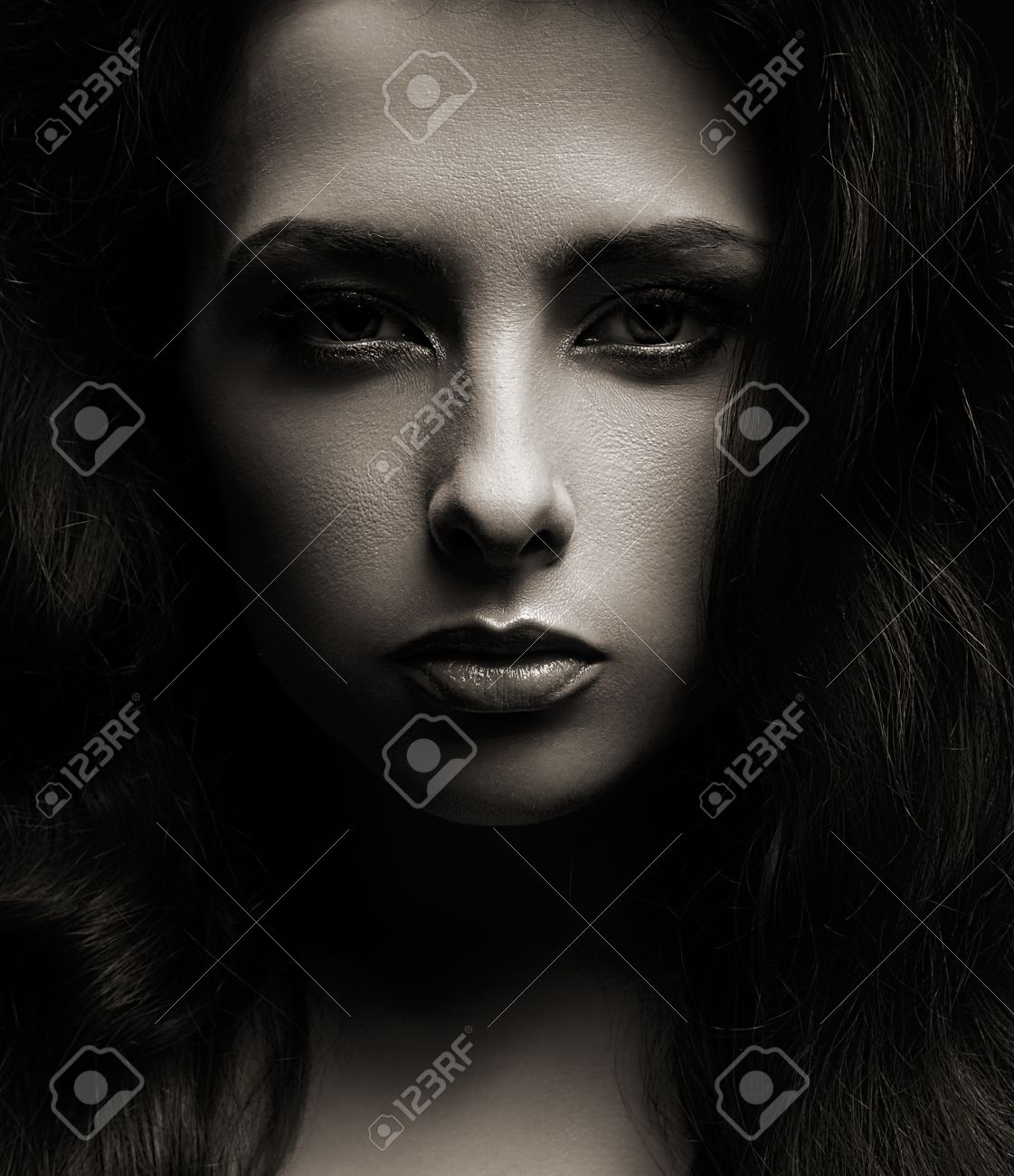 Closeup portrait of beautiful woman face on dark shadows background stock photo 28880750