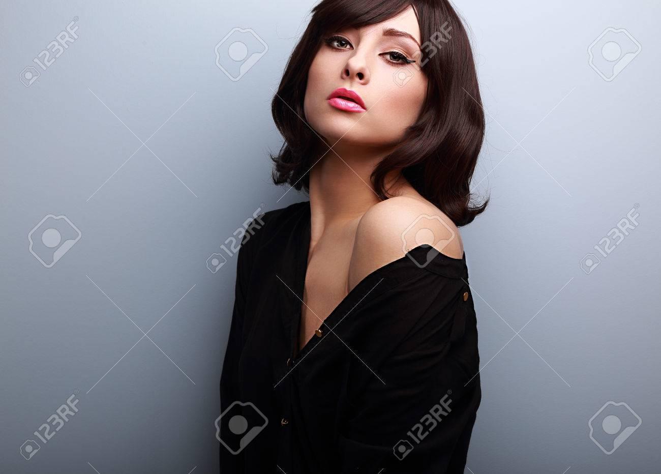 Sexy Short Hair Female Model Posing In Black Shirt On Blue