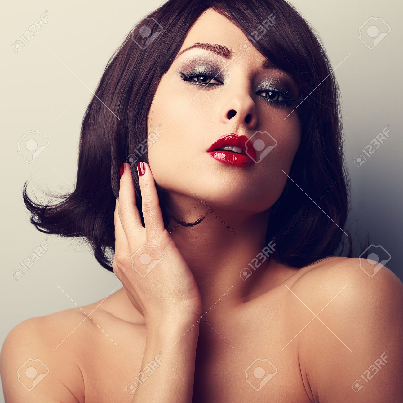 Hot Sexy Makeup Model With Short Black Hair Style And Red Lipstick